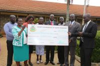Deputy Governor Wisley Rotich hands a a cheque for bursary to Chairperson Elgeyo Marakwet Headteachers Association